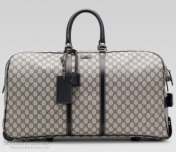 8c1d62313c8b Gucci travel bag duffel with wheels. This roomy duffel bag with wheels from  .